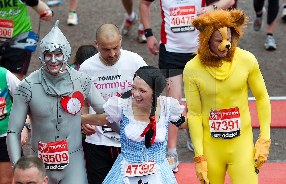 © London News Pictures. 22/04/2012. London, UK. Runners dressed as characters from the Wizard of OZ cross the finnish line at the 2012 Virgin London Marathon in London on April 22, 2012. Photo credit : Ben Cawthra /LNP