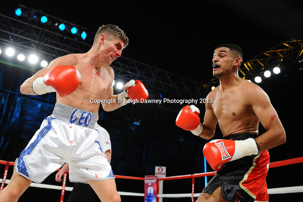 Muheeb Fazeldin (right) defeats Leo D'Erlanger in a boxing contest on Saturday 14th September 2013 at the Magna Centre, Rotherham. Hennessy Sports. Self billing applies. © Credit: Leigh Dawney Photography.
