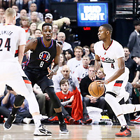 25 April 2016: Portland Trail Blazers forward Maurice Harkless (4) drives past Los Angeles Clippers forward Jeff Green (8) on a screen set by Portland Trail Blazers center Mason Plumlee (24) during the Portland Trail Blazers 98-84 victory over the Los Angeles Clippers, during Game Four of the Western Conference Quarterfinals of the NBA Playoffs at the Moda Center, Portland, Oregon, USA.