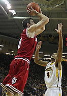 December 31 2012: Indiana Hoosiers forward Will Sheehey (0) puts up a shot as Iowa Hawkeyes guard/forward Roy Devyn Marble (4) defends during the second half of the NCAA basketball game between the Indiana Hoosiers and the Iowa Hawkeyes at Carver-Hawkeye Arena in Iowa City, Iowa on Monday December 31, 2012. Indiana defeated Iowa 69-65.