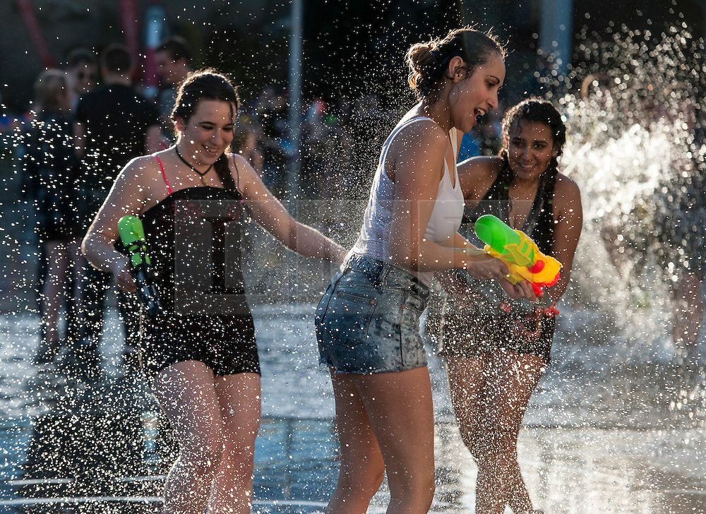 "© Licensed to London News Pictures. 03/06/2015. Bristol, UK.  Giant water fight in Bristol's Millennium Square, organised by The Smile Instigation Collective, a group who say they are dedicated to ""infecting people with happy"".   It is to celebrate the last session of the Smile Instigation Collective and includes decorating the fountains at Millennium Square with recycled flowers.  Photo credit : Simon Chapman/LNP"