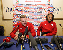 TIRANA, ALBANIA - Monday, November 19, 2018: Wales' Chris Gunter (L) and captain Ashley Williams during a press conference at the Tirana International Hotel ahead of the International Friendly match between Albania and Wales. (Pic by David Rawcliffe/Propaganda)