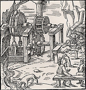 Rag-and-chain pump being used to raise water from a mine.  Two men are turning the drive-shaft on which is mounted a spur gear which transfers power to the pump by means of a lantern, D.  Apart from the chain connecting the 'rags', almost all the material used in the mechanism is wood.  From 'De re metallica', by Agricola, pseudonym of Georg Bauer (Basle, 1556).  Woodcut.