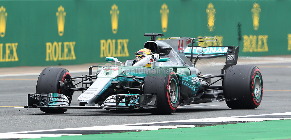 Mercedes Lewis Hamilton celebrates his pole position during qualifying for the 2017 British Grand Prix at Silverstone Circuit, Towcester.