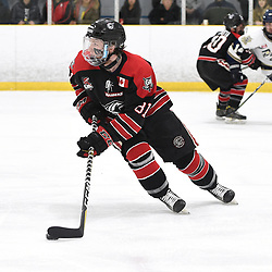 TORONTO, ON  - APR 10,  2018: Ontario Junior Hockey League, South West Conference Championship Series. Game seven of the best of seven series between Georgetown Raiders and the Toronto Patriots. Jason Smith #81 of the Georgetown Raiders skates with the puck during the first period.<br /> (Photo by Andy Corneau / OJHL Images)