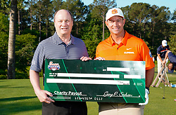 Peach Bowl, Inc. CEO & President Gary Stokan presents Clemson head football coach Dabo Swinney a check for his charity after the Chick-fil-A Peach Bowl Challenge at the Ritz Carlton Reynolds, Lake Oconee, on Tuesday, April 30, 2019, in Greensboro, GA. (Paul Abell via Abell Images for Chick-fil-A Peach Bowl Challenge)