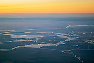 Aerial over the Sacramento - San Joaquin River Delta in the Central Valley at sunset, California