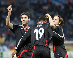 MARSEILLE, FRANCE - Tuesday, December 11, 2007: Liverpool's Ryan Babel celebrates scoring the fourth goal against Olympique de Marseille with team-mates Alvaro Arbeloa (L) and Yossi Benayoun (R) during the final UEFA Champions League Group A match at the Stade Velodrome. (Photo by David Rawcliffe/Propaganda)