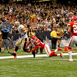 September 23, 2012; New Orleans, LA, USA; New Orleans Saints tight end Jimmy Graham (80) scores past Kansas City Chiefs cornerback Brandon Flowers (24) during the third quarter of a game at the Mercedes-Benz Superdome. The Chiefs defeated the Saints 27-24 in overtime. Mandatory Credit: Derick E. Hingle-US PRESSWIRE