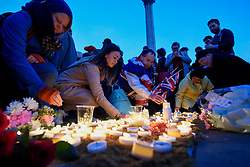 © Licensed to London News Pictures. 23/03/2017. London, UK. Londoners gather in Trafalgar Square for a candlelit vigil following the terrorist incident at the Houses of Parliament yesterday. Photo credit : Stephen Chung/LNP