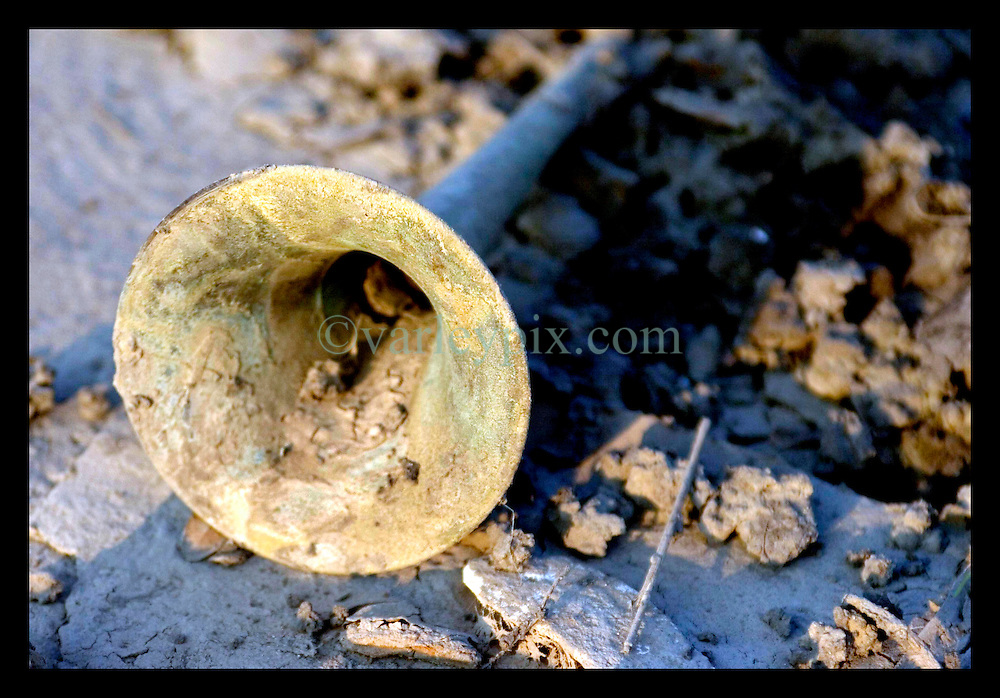 30th Sept, 2005. Hurricane Katrina aftermath, New Orleans, Louisiana. Lower 9th ward. The remnants of the lives of ordinary folks, now covered in mud as the flood waters recede. All that remains of a trumpet laying in the muck.