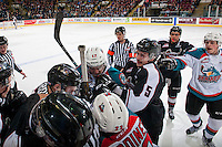 KELOWNA, CANADA - FEBRUARY 10: Ice officials attempt to break up a scrum at the boards between the Vancouver Giants and Kelowna Rockets on February 10, 2017 at Prospera Place in Kelowna, British Columbia, Canada.  (Photo by Marissa Baecker/Shoot the Breeze)  *** Local Caption ***