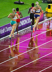 London, August 09 2017 .The leading pack splash their way along the rain soaked tack in the third of the women's 3,000m steeplechase heats on day six of the IAAF London 2017 world Championships at the London Stadium. © Paul Davey.