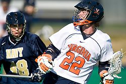 Virginia attackman Ryan Kelly (22) keeps the ball away from Navy defenseman Andy Tormey (48). The Virginia Cavaliers scrimmaged the Navy Midshipmen in lacrosse at the University Hall Turf Field  in Charlottesville, VA on February 2, 2008.