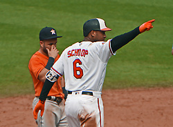 July 23, 2017 - Baltimore, MD, USA - Baltimore Orioles' Jonathan Schoop, right, points to the dugout as he celebrates his base hit that drove in an insurance run against the Houston Astros in the eighth inning on Sunday, July 23, 2017 at Oriole Park at Camden Yards in Baltimore, Md. The Orioles defeated the Astros, 9-7. (Credit Image: © Kenneth K. Lam/TNS via ZUMA Wire)