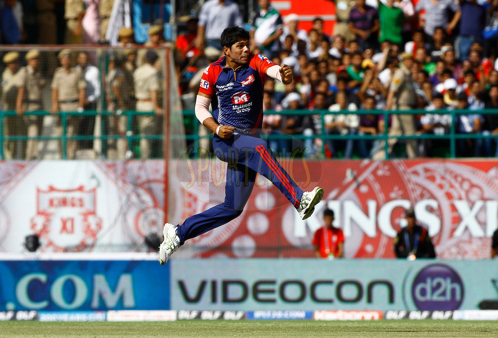 Delhi Daredevils player Umesh Yadav celebrates the wicket of Kings XI Punjab player Mandeep Singh during match 69 of the the Indian Premier League ( IPL) 2012  between The Kings X1 Punjab and The Delhi Daredevils held at the HPCA Stadium, Dharamsala, on the 19th May 2012..Photo by Pankaj Nangia/IPL/SPORTZPICS