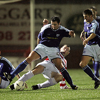 Hamilton v St Johnstone..29.12.04<br />David Hannah is tackled by Pat Keogh.<br /><br />Picture by Graeme Hart.<br />Copyright Perthshire Picture Agency<br />Tel: 01738 623350  Mobile: 07990 594431