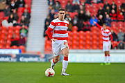 Doncaster Rovers No 24 Tommy Rowe In Action during the Sky Bet League 1 match between Doncaster Rovers and Wigan Athletic at the Keepmoat Stadium, Doncaster, England on 16 April 2016. Photo by Stephen Connor.