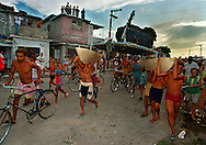 In 1994 Cuban balseros turned the tiny fishing village of Cojimar into a major point of embarkation for thousands seeking a better life. Here, Cubans run through the streets of Cojimar as they make their way towards the ocean to launch their raft for the U.S.