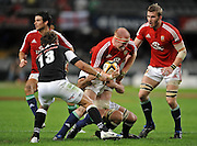 Paul O'Connell (Captain) of the Lions is tackled by Jacques Botes and Andries Strauss of the Sharks. On the right is Tom Croft of the Lions.<br /> Rugby - 090610 - British&Irish Lions v Sharks - ABSA Stadium - Durban - South Africa. The Lions won 37 -3.<br /> Photographer : Anton de Villiers / SASPA