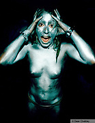 Screaming naked clubber covered in silver body paint Ibiza 1999