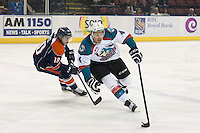KELOWNA, CANADA - FEBRUARY 6: Matt Revel #10 of Kamloops Blazers back checks Madison Bowey #4 of Kelowna Rockets during first period on February 6, 2015 at Prospera Place in Kelowna, British Columbia, Canada.  (Photo by Marissa Baecker/Shoot the Breeze)  *** Local Caption *** Matt Revel; Madison Bowey;