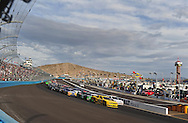 Nov. 12 2011; Avondale, AZ, USA; NASCAR Nationwide Series driver Sam Hornish Jr. (12) leads a pack of cars during the Wypall 200 at Phoenix International Raceway. Mandatory Credit: Jennifer Stewart-US PRESSWIRE