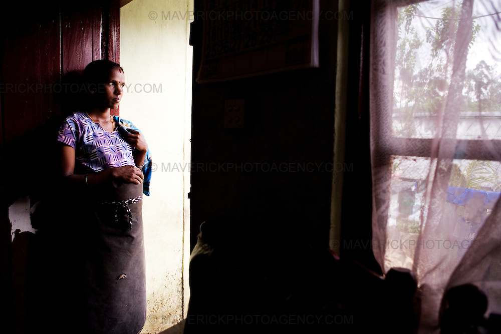 A pregnant tea worker stands at the door of her home...Sri Lanka is a world leader in tea export, and its tea is considered among the best in the world. British colonists transported thousands of Tamil people from South India under brutal conditions for indentured labour on the plantations. Presently, strong unions and greater awareness of rights has somewhat improved the conditions of tea estate workers who live and work on tea estates. Women form the majority of the workforce and are 'trapped' at the lower end of the labour hierarchy. Female tea-pluckers have to juggle labour with sole-responsibility for family and household-care, normally working 14 hours a day...Picture Michael Hughes/Maverick