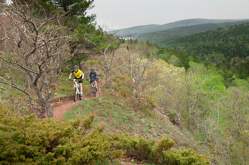 Mountain bikers ride the Woopidy Woo single track trail along Brockway Mountain in Copper Harbor Michigan.
