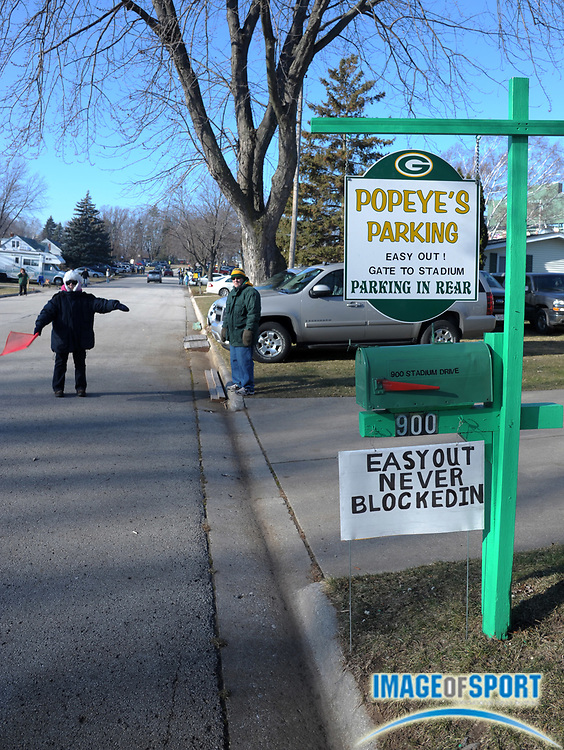 Dec 11, 2011; Green Bay, WI, USA; Residents on Stadium Drive solicit parking before the NFL game between the Oakland Raiders and the Green Bay Packers at Lambeau Field.