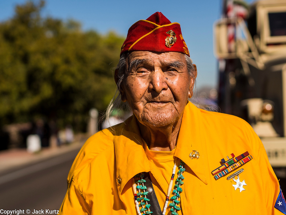 "11 NOVEMBER 2013 - PHOENIX, AZ: JOE KELLWOOD, one of the few surviving Navajo Code Talkers from World War II, walks the Phoenix Veterans Day Parade. The Phoenix Veterans Day Parade is one of the largest in the United States. Thousands of people line the 3.5 mile parade route and more than 85 units participate in the parade. The theme of this year's parade is ""saluting America's veterans.""    PHOTO BY JACK KURTZ"