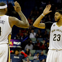 Mar 21, 2017; New Orleans, LA, USA; New Orleans Pelicans forward Anthony Davis (23) high fives forward DeMarcus Cousins (0) during the second half of a game against the Memphis Grizzlies at the Smoothie King Center. The Pelicans defeated the Grizzlies 95-82. Mandatory Credit: Derick E. Hingle-USA TODAY Sports
