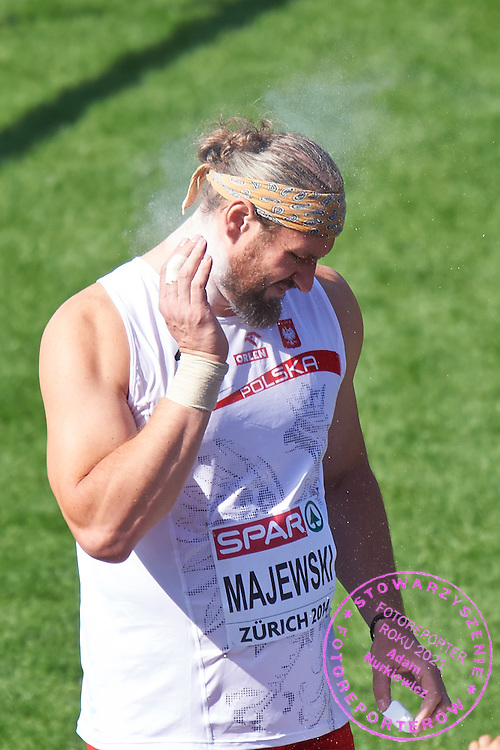 Tomasz Majewski of Poland competes in men's shot put qualification during the First Day of the European Athletics Championships Zurich 2014 at Letzigrund Stadium in Zurich, Switzerland.<br /> <br /> Switzerland, Zurich, August 12, 2014<br /> <br /> Picture also available in RAW (NEF) or TIFF format on special request.<br /> <br /> For editorial use only. Any commercial or promotional use requires permission.<br /> <br /> Photo by &copy; Adam Nurkiewicz / Mediasport