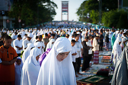 Image ©Licensed to i-Images Picture Agency. 28/07/2014. South Sumatera Province. Indonesia. <br /> 61981793<br /> Muslims gather on the main way in front of the Great Mosque Palembang to attend the Eid Al-Fitr celebration in Palembang, South Sumatera Province in Indonesia, on July 28, 2014. Eid Al-Fitr marks the end of the Muslim fasting month of Ramadan. Picture by  imago / i-Images<br /> UK ONLY