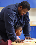 "Mike Horton reads to his daughter Makayla Horton during  ""Join Your Kids at Kindergarten"" day at Presidential Park Elementary School in Middletown on Monday, Sept. 9, 2013."