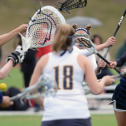 Staff photos by Tom Kelly IV<br /> Episcopal's Jane Crager (5) drives toward the net, shoots, and scores between a plethora of Notre Dame players during the Episcopal Academy at Notre Dame girls lacrosse game on Tuesday afternoon, March 31, 2015.