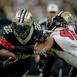 Nov 22, 2018; New Orleans, LA, USA; New Orleans Saints running back Mark Ingram II (22) breaks a tackle by Atlanta Falcons safety Sharrod Neasman (41) during the third quarter at the Mercedes-Benz Superdome. Mandatory Credit: Derick E. Hingle-USA TODAY Sports
