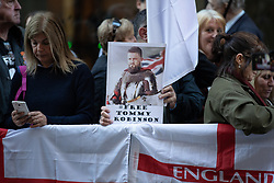 © Licensed to London News Pictures . 27/09/2018 . London , UK . Supporters of Tommy Robinson outside the Old Bailey , ahead of the start of his retrial . Supporters of and those against former EDL leader Tommy Robinson (real name Stephen Yaxley-Lennon ) outside the Old Bailey , as Robinson faces a retrial for Contempt of Court following his actions outside Leeds Crown Court in May 2018 . Robinson was already serving a suspended sentence for the same offence when convicted in May and served time in jail as a consequence , but the newer conviction was quashed by the Court of Appeal and a retrial ordered . Photo credit: Joel Goodman/LNP