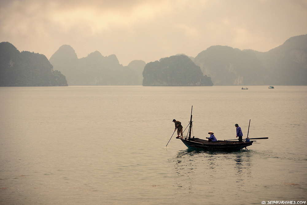 Vietnamese fishermen troll the scenic waters of Ha Long Bay, Vietnam. May 5, 2008