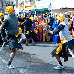 London, UK - 7 April 2013: Martial arts shows are played during the procession.