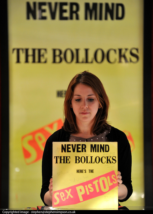 © licensed to London News Pictures. LONDON, UK.  24/06/11 A Bonhams assistant holds a personal signed copy of Sid Vicious' 'Never Mind the Bollocks Here's the Sex Pistols' . The album comes with a letter by former Sex Pistol Steve Jones, verifying it's authenticity. Photo call for highlights form Bonhams' upcoming Entertainment Memorabilia Sale. .Mandatory Credit Stephen Simpson/LNP