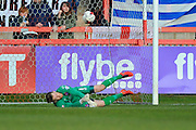 Carlisle Utd goalkeeper Mark Gillespie is unable to keep out Exeter City's Jayden Stockley's shot which gave exeter a 1-0 lead during the Sky Bet League 2 match between Exeter City and Carlisle United at St James' Park, Exeter, England on 12 March 2016. Photo by Graham Hunt.