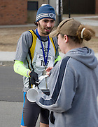 Dave Bresnahan, the winner of the 2009 5K Frostbite Run receives a medal and complimentary cup for running in the race.  Approximately 100 people braved the cold weather to participate in this year's run.