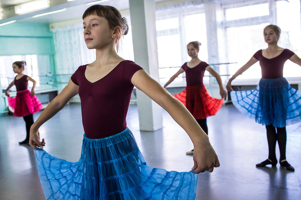 Ballet students practice at a school for the arts on Tuesday, October 22, 2013 in Baikalsk, Russia.