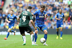Jake Reeves of AFC Wimbledon tackles Carl McHugh of Plymouth Argyle - Mandatory by-line: Robbie Stephenson/JMP - 30/05/2016 - FOOTBALL - Wembley Stadium - London, England - AFC Wimbledon v Plymouth Argyle - Sky Bet League Two Play-off Final