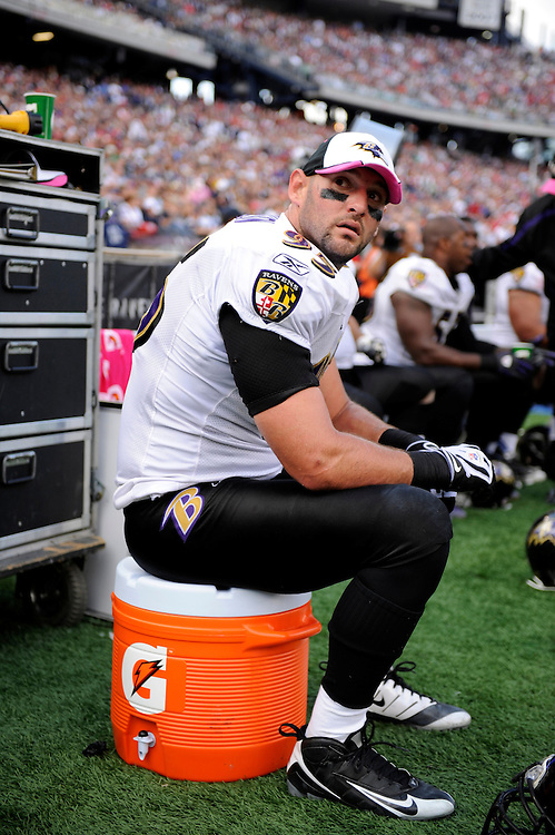 FOXBORO, MA - OCTOBER 04: Jarret Johnson #95 of the Baltimore Ravens looks on while sitting on a Gatorade bucket during a game against the New England Patriots at Gillette Stadium on October 4, 2009 in Foxboro, Massachusetts. The Patriots defeated the Ravens 27 to 21. (Photo by Rob Tringali) *** Local Caption *** Jarret Johnson