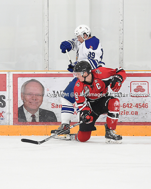 STOUFFVILLE, ON - Oct 3, 2015 : Ontario Junior Hockey League game action between Markham and Stouffville, Connor Inger #9 of the Cobourg Cougars keeps the puck from Tyson Bruce #89 of the Markham Royals during the third period.<br /> (Photo by Andy Corneau / OJHL Images)