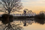 UNITED KINGDOM, London: 18 December 2017 A cyclist rides past a small lake during a cold and frosty morning in  Richmond Park, London earlier today. Rick Findler / Story Picture Agency