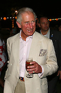 PERTH, AUSTRALIA - NOVEMBER 14:  Prince Charles, Prince of Wales smiles with a drink in his hand as he attends a reception with Camilla, Duchess of Cornwall to celebrate the Prince's birthday at the Cottesloe Civic Centre on November 14, 2015 in Perth, Australia. The Royal couple are on a 12-day tour visiting seven regions in New Zealand and three states and one territory in Australia.  (Photo by Paul Kane/Getty Images)