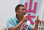 Actor, Taro Yamaoto speaking to crowds outside Tamachi Station as he campaigns for the House of Councillors election in Tokyo, Japan Friday July 12th 2013 The election will ake place on July 21st. Yamamoto is running as an independent candidate with a strong anti-nuclear power message.